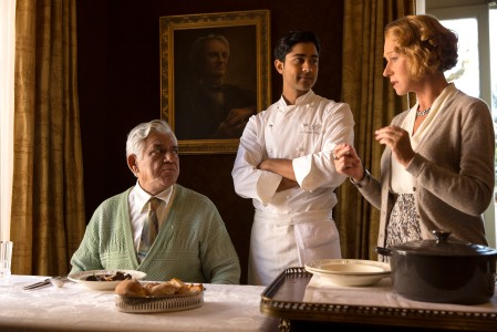 "HFJ-0087r In DreamWorks Pictures' charming new film ""The Hundred-Foot Journey,"" Hassan (MANISH DAYAL, center) serves his father (OM PURI) Beef Bourguinon á la Hassan, a classic French dish with an Indian twist, as Madame Mallory (HELEN MIRREN) explains its significance to French chefs. Photo: Francois Duhamel ©DreamWorks II Distribution Co., LLC. All Rights Reserved."